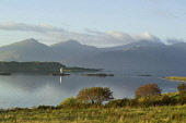 A small lighthouse on an islet on Loch Linnhe near Port Appin with a view beyond to the mountains of Morvern, Argyll, Scotland. Allan Wright / Scottish Viewpoin horizontal,outdoors,outside,day,sunny,sunshine,autumn,Port Appin,Loch Linnhe,Morvern,Argyll,Scotland,Scottish,UK,U.K,Great Britain,water,hills,mountains,nobody,lighthouse,calm,atmospheric,islet