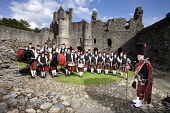 The Dufftown and District  Pipe Band at Balvenie Castle, Moray, Scotland John Paul / Scottish Viewpoint uk,u.k,Great Britain,GB,G.B,Scotland,Scottish,day,outdoors,summer,pipers,band,bagpipes,kilts,kilt,drummers,drummer,pipe band,bagpiper,bagpipers,Balvenie Castle,Moray,group