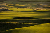 One of the greens in late evening sunshine at Royal Dornoch Golf Club, Highlands of Scotland John Paul / Scottish Viewpoint uk,u.k,Great Britain,GB,G.B,Scotland,Scottish,day,Highlands,outdoors,summer,sunny,nobody,Royal Dornoch Golf Club,course,golf,golfing,green,bunker,flag