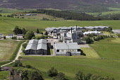 An aerial view of the Glenlivet Distillery near Ballindalloch, Moray, Scotland. John Paul / Scottish Viewpoint horizontal,outside,outdoors,exterior,summer,sunny,aerial,elevated,day,Glenlivet Distillery,Ballindallloch,Moray,Scotland,Scottish,UK,U.K,Great Britain,nobody,single malt,whisky,Speyside,spirit,product