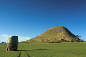 North Berwick Law with a dovecot in the foreground, East Lothian, Scotland. Keith Fergus / Scottish Viewpoin horizontal,outdoors,outside,day,winter,sunny,sunshine,blue sky,East Lothian,North Berwick,North Berwick Law,nobody,Scotland,Scottish,UK,U.K,Great Britain,field,dovecot,whale bone arch