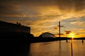 Sunset over the River Clyde, with the BBC and the Science Centre silhoutted against the glowing sky, Glasgow, Scotland Tony Clerkson/ Scottish Viewpoin Clyde,Glasgow,Glasgow Science Centre,River Clyde,Science Centre,Scotland,Scottish weather,architecture,atmospheric,city,cityscape,clouds,color,colorful,colour,colourful,engineering,glowing,landmark,no