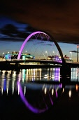 The Clyde Arc, also known as the Squinty Bridge, is lit up as night falls with STV and BBC offices in the background and the lights reflecting on the River Clyde, Glasgow, Scotland Tony Clerkson/ Scottish Viewpoin Arc,Clyde Arc,Clydeside,Glasgow,Squinty Bridge,clouds,color,colour,colourful,dusk,engineering,landmark,landmarks,lights,lights reflected in water,night cityscape,reflection,riverside,skies,structure,w