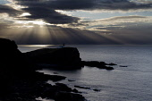 Moody sky and crepuscular rays behind Stoer Head and the Lighthouse, Sutherland, Highlands of Scotland Mark Ferguson/ Scottish Viewpoin Highlands of Scotland,cliff,cliffs,dramatic,coast,coastal,coastline,water,sea,nobody,outdoors,sunset,uk,u.k,Great Britain,GB,G.B,Scotland,Scottish,ocean,remote,Sutherland,atmospheric,autumn,Stoer Head