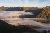Morning mist in the Valley looking down into the Pass of Glencoe from Stob Coire Raineach, Highlands of Scotland Jason Baxter / Scottish Viewpoin Aonach Eagach,Highlands of Scotland,Glencoe,glen,coe,nobody,outdoors,daytime,uk,u.k,Great Britain,GB,G.B,Scotland,Scottish,Ben Nevis,atmospheric,mountain,mountains,hill,hills,munro,autumn,summer