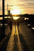 Sunset lights up Glasgow along the River Clyde silhouetting the Kingston Bridge and people walking and exercising in the sunshine. Glasgow, Scotland Tony Clerkson / Scottish Viewpoi People,outdoors,daytime,uk,u.k,Great Britain,GB,G.B,Scotland,Scottish,Glasgow,autumn,silhouette River Clyde,Kingston,bridge,bridges,cityscape,walkers,walking,cycling,cyclist,cyclists,bike,bikes,biking