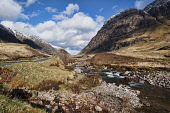 River Coe in Glencoe, Highlands of Scotland Dennis Barnes/ Scottish Viewpoin uk,u.k,Great Britain,GB,G.B,Scotland,Scottish,outdoors,daytime,nobody,spring,river,glencoe,glen,coe,highlands,mountain,mountains,hill,hills,snow,road,empty,river coe,single track