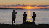 3 people catching the sunset across the sea on their cameras, Scotland Bill McKenzie/ Scottish Viewpoin uk,u.k,Great Britain,GB,G.B,Scotland,Scottish,3 people,outdoors,daytime,spring,coast,coastal,coastline,water,sea,tourists,tourist,visitors,visitor,sunset,sunsetting