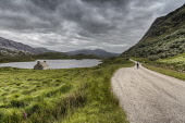 A cyclist on a road passing Loch Stack, Sutherland, Highlands of Scotland. Bill McKenzie/ Scottish Viewpoin uk,u.k,Great Britain,GB,G.B,Scotland,Scottish,1 person,outdoors,daytime,spring,cycling,cyclist,cyclists,bike,bikes,biking,biker,bikers,bicycle,bicycles,Sutherland,mountain,mountains,hill,hills,Loch St