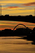 Sunset lights up Glasgow along the River Clyde silhouetting the Kingston Bridge and the Clyde Arc, known locally as the Squinty Bridge, Scotland Tony Clerkson/ Scottish Viewpoin uk,u.k,Great Britain,GB,G.B,Scotland,Scottish,nobody,night,time,outdoors,winter,glasgow,lit up,river clyde,clyde arc,bridge,bridges,kingston bridge,sunset,squinty