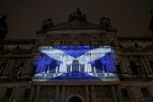 A saltire flag projected onto the City Chambers, Glasgow during a WWF energy awareness event. Scotland Iain McLean/ Scottish Viewpoint uk,u.k,Great Britain,GB,G.B,Scotland,Scottish,nobody,night,time,outdoors,winter,glasgow,flag,saltire,flags