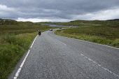 Cycling on the A859 road from Stornoway to Tarbert, Isle of Lewis,  Outer Hebrides, Scotland. Iain McLean/ Scottish Viewpoint uk,u.k,Great Britain,GB,G.B,Scotland,Scottish,1 person,daytime,outdoors,Outer Hebrides,western isles,cycling,cyclist,cyclists,bike,bikes,biking,biker,bikers,bicycle,bicycles,Isle of Lewis,lewis