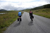Cycling on the A859 road from Stornoway to Tarbert, Isle of Lewis,  Outer Hebrides, Scotland. Iain McLean/ Scottish Viewpoint uk,u.k,Great Britain,GB,G.B,Scotland,Scottish,2 people,daytime,outdoors,Outer Hebrides,western isles,cycling,cyclist,cyclists,bike,bikes,biking,biker,bikers,bicycle,bicycles,Isle of Lewis,lewis,island