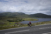 A cyclist on the road,  Isle of Harris,  Outer Hebrides, Scotland. Iain McLean/ Scottish Viewpoint uk,u.k,Great Britain,GB,G.B,Scotland,Scottish,1 person,daytime,outdoors,Outer Hebrides,western isles,cycling,cyclist,cyclists,bike,bikes,biking,biker,bikers,bicycle,bicycles,Harris,island,islands,isle