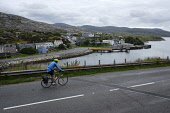 A cyclist on the road looking down to Tarbert,  Isle of Harris,  Outer Hebrides, Scotland. Iain McLean/ Scottish Viewpoint uk,u.k,Great Britain,GB,G.B,Scotland,Scottish,1 person,daytime,outdoors,Outer Hebrides,western isles,cycling,cyclist,cyclists,bike,bikes,biking,biker,bikers,bicycle,bicycles,Harris,tarbert,island,isla