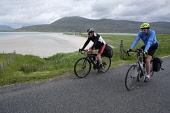 Two cyclists on the  Isle of Harris,  Outer Hebrides, Scotland. Iain McLean/ Scottish Viewpoint uk,u.k,Great Britain,GB,G.B,Scotland,Scottish,2 people,daytime,outdoors,Outer Hebrides,western isles,cycling,cyclist,cyclists,bike,bikes,biking,biker,bikers,bicycle,bicycles,Harris,island,islands,isle