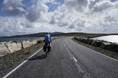 A cyclist on Berneray,  Outer Hebrides, Scotland. Iain McLean/ Scottish Viewpoint uk,u.k,Great Britain,GB,G.B,Scotland,Scottish,1 person,daytime,outdoors,Outer Hebrides,western isles,cycling,cyclist,cyclists,bike,bikes,biking,biker,bikers,bicycle,bicycles,island,islands,isle,isles