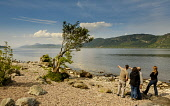 Tourists looking over Loch Ness from the eastern shore near Foyers, Highlands of Scotland Andrew Wilson/ Scottish Viewpoin uk,u.k,Great,Britain,GB,G.B,Scotland,Scottish,4 people,daytime,outdoors,summer,Highlands of Scotland,Loch Ness,coast,coastal,coastline,water