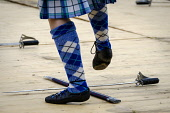 Peebles, Scotland UK  3rd September 2016. Peebles Highland Games, the biggest 'highland' games in the Scottish  Borders took place in Peebles on September 3rd 2016 featuring pipe band contests, highla... Andrew Wilson / Scottish Viewpoint uk,u.k,Great Britain,GB,G.B,Scotland,Scottish,group,daytime,outdoors,Highland Games,competitions,borders,highland,dancing,dance,feet,legs,sword,tartan,kilts