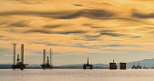 Oil rigs/ drilling platforms moored in Cromarty Firth in Ross and Cromarty, Highland, Scotland, United Kingdom Iain Masterton / Scottish Viewpoint oil,rig,platform,drilling,cromarty,firth,Scotland,evening,sunset,industry,gas,petroleum,energy,copyspace,offshore,Scottish,harbour,moored,industrial,structure,rigs,north,sea,view,daytime,outdoor,Unite