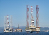 Oil rigs / drilling platforms moored in Cromarty Firth in Ross and Cromarty, Highland, Scotland, United Kingdom Iain Masterton / Scottish Viewpoint oil,rig,rigs,platform,drilling,cromarty,firth,Scotland,industry,gas,petroleum,energy,Scottish,harbour,offshore,moored,industrial,structure,north,sea,view,daytime,outdoor,United Kingdom,British,Britain