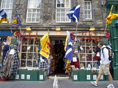 Exterior of tourist shop with Scottish flags on Royal Mile in Edinburgh Scotland Iain Masterton / Scottish Viewpoint Edinburgh,Scotland,Scottish,shop,tourism,tourist,capital,city,exterior,shopping,retail,flags,Europe,European,British,United Kingdom,Royal Mile,High Street,street,souvenir,store