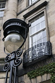Detail of ornate street lamp and stone Georgian house in historic New Town of Edinburgh in Scotland Iain Masterton / Scottish Viewpoint WEdinburgh,Scotland,New Town,Scottish,historic,detail,street,lamp,light,exterior,housing,house,stone,traditional,architecture,residential,district,Britain,British,United Kingdom,UK,capital,city,herita