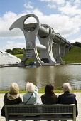Visitors looking at The Falkirk Wheel a modern ship lift on the Forth and Clyde Canal in Scotland Iain Masterton / Scottish Viewpoint Scotland,Scottish,Falkirk,Wheel,canal,lift,ship,engineering,structure,technology,transport,travel,outdoor,landmark,modern,Forth,Clyde,Britain,British,Europe,European,United Kingdom