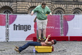 Street performer on High Street during Edinburgh Fringe Festival 2016 in Scotland , United Kingdom Iain Masterton / Scottish Viewpoint Edinburgh,fringe,festival,festivals,outdoor,Scotland,Scottish,artist,artists,performer,performers,street,daytime,United,Kingdom,UK,Britain,British,culture,cultural,actor,Europe,European,city,cities,in