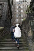 Musician carrying cello up narrow lane during Edinburgh Festival 2016 in Scotland, United Kingdom Iain Masterton / Scottish Viewpoint Edinburgh,fringe,festival,festivals,outdoor,Scotland,musician,Scottish,street,daytime,United,Kingdom,UK,Britain,British,culture,cultural,Europe,European,city,cities,international
