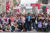 Large crowd watch street performance on High Street during Edinburgh Fringe Festival 2016 in Scotland , United Kingdom Iain Masterton / Scottish Viewpoint Edinburgh,fringe,festival,festivals,outdoor,Scotland,Scottish,crowd,audience,public,people,busy,street,daytime,United,Kingdom,UK,Britain,British,culture,cultural,Europe,European,city,cities,internatio