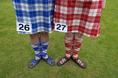 Female highland dancers in kilts before competition at  Braemar Junior Highland Games in July in Scotland United Kingdom Iain Masterton / Scottish Viewpoint Braemar,Junior,Highland,Games,Scotland,dancers,Scottish,detail,kilts,kilt,female,girls,ladies,women,competitors,dress,traditional,costume,skirts,standing,dancing,heritage,competition,dance,UK,United K