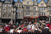 Many bars and restaurants in Grassmarket district of Edinburgh , Scotland, United Kingdom Iain Masterton / Scottish Viewpoint Edinburgh,Grassmarket,pub,bar,restaurant,busy,pubs,people,bars,cafe,cafes,outdoor,historic,heritage,district,city,capital,cities,tourism,tourists,travel,street,daytime,Scotland,Scottish,Britain,Britis