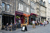 View of pubs and cafes along historic street in Grassmarket district of Edinburgh , Scotland, United Kingdom Iain Masterton / Scottish Viewpoint Edinburgh,Grassmarket,busy,people,square,outdoor,pubs,bars,cafe,cafes,bar,pub,historic,heritage,district,city,capital,cities,tourism,tourists,travel,street,daytime,Scotland,Scottish,Britain,British,Un