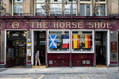 Exterior of famous Horseshoe Bar in Glasgow, Scotland, united Kingdom Iain Masterton / Scottish Viewpoint Horse,shoe,bar,Glasgow,horseshoe,pubs,bars,Sotland,Scottish,exterior,outside,1 person,Britain,British,United,Kingdom