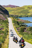 Motorists and bikers on remote highway A894 part of North Coast 500 tourist route, in Highland Region, near Scourie north Scotland in summer,United Kingdom Iain Masterton / Scottish Viewpoint road,Scotland,north,coast,500,Scottish,highway,narrow,roads,transport,transportation,infrastructure,traffic,tourists,rural,remote,touring,countryside,travel,tourism,tourist,route,routes,Highland,north