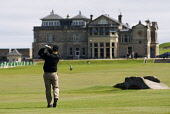 Golfer drives from Tee  on 18th hole at Old Course in St Andrews Scotland Iain Masterton / Scottish Viewpoint Britain,Leisure,Old Course,Recreation,Scotland,St Andrews,United Kingdom,clubhouse,course,golf,golfer,outside,sports,sportsman,Royal and Ancient,Scottish