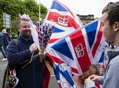 Man selling union jack flags at  Orange Walk parade in central Glasgow , Scotland, United Kingdom Iain Masterton / Scottish Viewpoint Glasgow,Scotland,Scottish,flag,seller,union jack,religion,protestant,marches,Britain,British,united Kingdom,city,cities,parade,unionist,flags