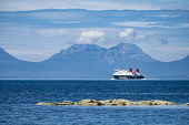View of The Paps of Jura mountains on the Island of Jura and CalMac passenger ferry from Kintyre Peninsula in Argyll and Bute , Inner Hebrides,Scotland , United Kingdom Iain Masterton / Scottish Viewpoint paps,of,Jura,Islay,Isle,Island,Inner,hebrides,Scotland,Scottish,Mountain,mountains,range,scenic,transport,ferry,calmac,ferries,landscape,Argyll,Bute,Britain,british,United Kingdom,outdoor,daytime,nobo