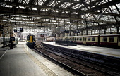 A local ScotRail commuter passenger train arriving at Central Station in Glasgow, Scotland Editorial use only Andrew Wilson / Scottish Viewpoint Glasgow,Glasgow Central,Scotland,arriving,departing,diesel,Network Rail,passengers,railway,railway station,ScotRail,trains,track,line,platform,arrive