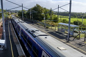 A local ScotRail commuter passenger train leaving Carluke Station in South Lanarkshire, Scotland Editorial use only Andrew Wilson / Scottish Viewpoint Scotland,arriving,departing,diesel,Network Rail,passengers,railway,railway station,ScotRail,trains,Carluke,station,travel,transport,speed,South Lanarkshire