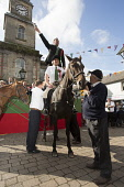 Langholm Common Riding 2016. First Fair Crying, Proclamation of Langholm Fair and Common Riding done by standing on a horses backs, Dumfries and Galloway Allan Devlin / Scottish Viewpoint Langholm,Common,Riding,2016,Dumfries,Galloway,Scotland,UK,Scottish,border,town,centre,local,tradition,historic,custom,horse,fair,crying,stand,horseback,procession,festival
