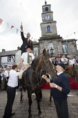 Langholm Common Riding 2016Langholm Common Riding 2016. Second Fair Crying, Proclamation of Langholm Fair and Common Riding done by standing on a horses back, Dumfries and Galloway Allan Devlin / Scottish Viewpoint Langholm,Common,Riding,2016,Dumfries,Galloway,Scotland,UK,Scottish,border,town,centre,local,tradition,historic,custom,horse,procession,festival,fair,crying,proclamation