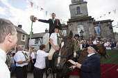 Langholm Common Riding 2016. First Fair Crying, Proclamation of Langholm Fair and Common Riding done by standing on a horses backs. Barley Bannock and salted herring, Dumfries and Galloway Allan Devlin / Scottish Viewpoint Langholm,Common,Riding,2016,Dumfries,Galloway,Scotland,UK,Scottish,border,town,centre,local,tradition,historic,custom,horse,procession,festival,Barley,Bannock,salted,herring,symbol,symbolisim