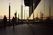 Reflection of the Squiggly Bridge as the sun sets in Glasgow, Scotland Tony Clerkson / Scottish Viewpoint uk,u.k,Great Britain,GB,G.B,Scotland,Scottish,2 people,daytime,outdoors,glasgow,bridge,reflection,sunset,squiggly