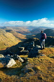 A distant Loch Arklet from Beinn Ime, the Arrochar Alps, Loch Lomond and the Trossachs National Park, Scotland Keith Fergus/ Scottish Viewpoint uk,u.k,Great Britain,GB,G.B,Scotland,Scottish,1 person,daytime,outdoors,autumn,Loch Lomond and the Trossachs National Park,Loch Arklet,Arrochar Alps,mountain,mountains,hill,hills,walk,walking,walker,w