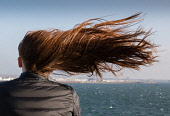 Girl on ferry crossing between Ardrossan and Arran. Scotland Robert Perry/ Scottish Viewpoint uk,u.k,Great Britain,GB,G.B,Scotland,Scottish,1 person,daytime,outdoors,red,hair,blowing,wind,ginger,long,girl,young,woman,texture