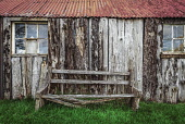Old timber and corrugated iron byre with remains of seat, Highlands of Scotland Alan Gordon/ Scottish Viewpoint uk,u.k,Great Britain,GB,G.B,Scotland,Scottish,nobody,daytime,outdoors,Ardelve,Dornie,Highlands,Lochalsh,agricultural,atmospheric,building,byre,corrugated iron,old,seat,timber,weathered,window,wood,woo