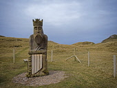 Chessman Sculpture at Uig Beach Isle of Lewis Outer Hebrides , Scotland Allan Coutts/ Scottish Viewpoint uk,u.k,Great Britain,GB,G.B,Scotland,Scottish,nobody,daytime,archaeology,ardroil,beach,blue,carving,chessman,chessmen,commission,commissioned,community,council,crown,dunes,famous,figural,figure,gaelic