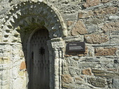 St. Oran's Chapel. Doorway, entrance. Alongside the Abbey Church, Iona. Inner Hebrides, Scotland Allan Coutts/ Scottish Viewpoint uk,u.k,Great Britain,GB,G.B,Scotland,Scottish,nobody,daytime,abbey,arch,architectural,architecture,building,carved,chapel,chiseled,christian,church,coast,coastal,decorated,door,doorway,ecclesiastical,